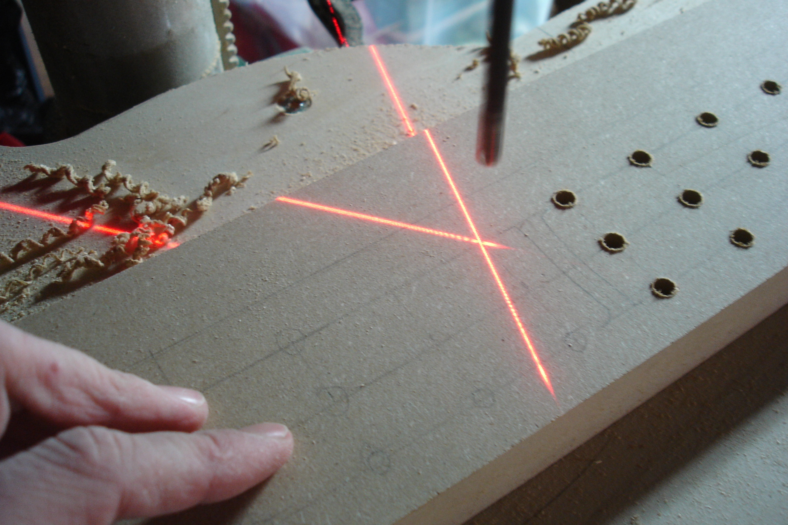 The laser cross is very helpful when it comes to drilling many holes fast - it indicates exactly where the center of the drill bit will cut into the wood.