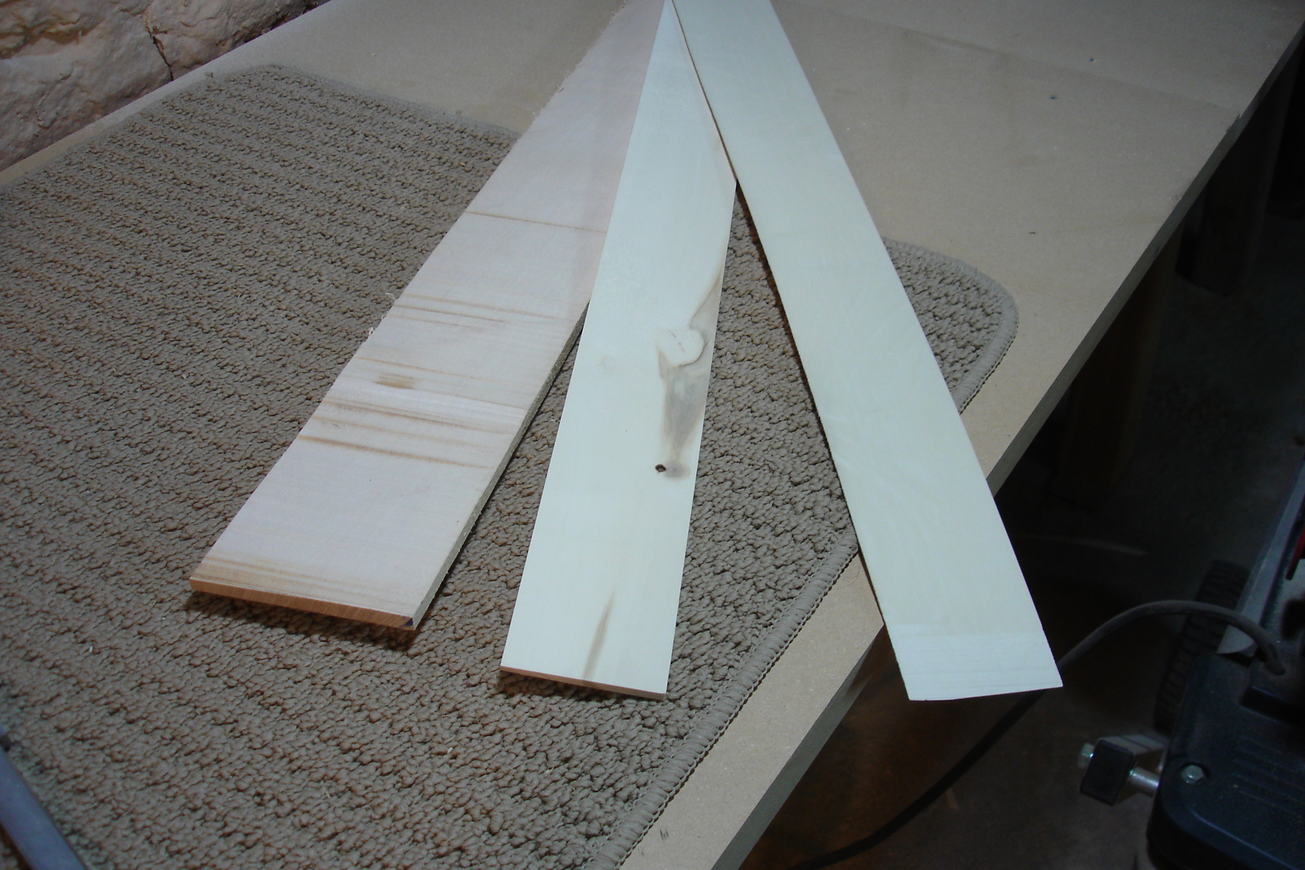 Veneer from start to finish: a solid piece of wood from the supplier (bottom sheet), a resawed unthicknessed piece with one smooth side from the jointer (middle) and a thicknessed veneer (top).