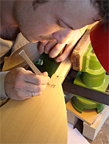 Working on an inlay on a Saz.